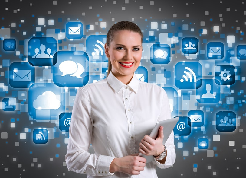 Young smiling businesswoman with application icons in background