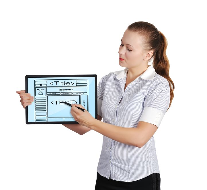 20590250 - woman holding touch pad with template web page